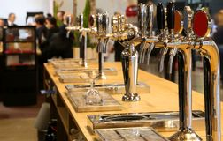 Draught beer taps on the counter of a pub royalty free stock image