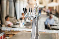 Draught beer taps and other beverages. Draught beer taps and other beverages in a bar Stock Photography