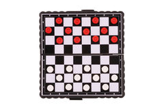Draughts. The image of chessboard with white and red draughts Stock Photo