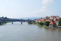 Drava river in slovenian town Maribor. The picture of Drava river and slovenian town lying on it Stock Photography