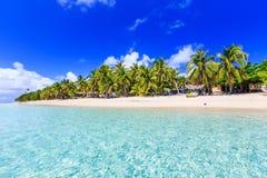 Dravuni Island, Fiji. Beach on a tropical island with clear blue water. Dravuni Island, Fiji Royalty Free Stock Images
