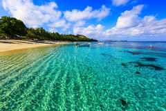 Dravuni Island, Fiji. Crystal clear waters on the shores of Dravuni Island Stock Image
