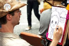Draw. The portrait is drawn by a simple pencil a hand of the street Korean artist which draws a cartoon from people in the street Insadong in city of Seoul South Royalty Free Stock Images
