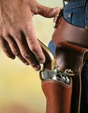 Draw 2. Cowboys hand at waist level reaching for gun as if to draw Stock Photo