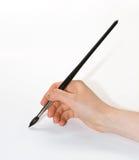 Draw. On white paper. black brush Stock Images