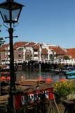 Draw bridge behind historic cast iron street lantern in Leiden NL Royalty Free Stock Photo