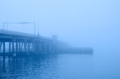 Draw bridge disappearing into heavy fog Royalty Free Stock Photo