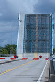 Draw Bridge Up. An old draw bridge, still in use, in the up position allows boat traffic to pass on the St Lucie River in Florida Royalty Free Stock Photography