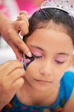 Draw butterfly on girl face Stock Images
