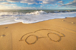 Draw car on beach sand. Conceptual design Stock Photography