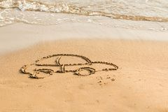 Draw car on beach sand. Conceptual design.Symbol car. concept of risk in real estate financing.drawing on the beach. Draw car on beach sand. Conceptual design royalty free stock photo