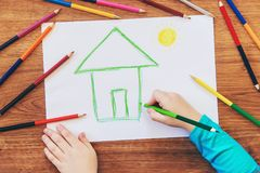 Draw child house family. Selective focus royalty free stock photos