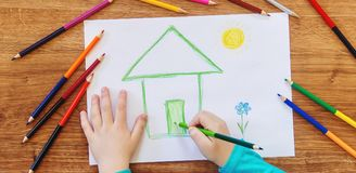 Draw child house family. Selective focus stock images