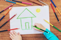 Draw child house family. Selective focus royalty free stock photo