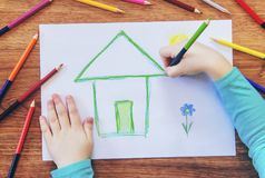 Draw child house family. Selective focus royalty free stock images