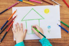 Draw child house family. Selective focus stock image