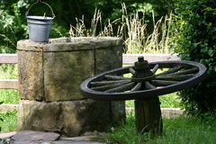 Draw-Fountain. Fountain with car wooden wheel and bucket Royalty Free Stock Image