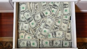 Draw Full of Hidden US Dollar Bills Money. A draw is opened to reveal a hidden stash of $1 US bills. Serial numbers on bills removed stock video
