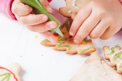Draw on gingerbread cookies Royalty Free Stock Photography