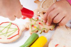 Draw on gingerbread cookies Royalty Free Stock Photo