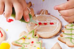 Draw on gingerbread cookies Royalty Free Stock Image