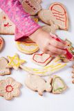 Draw on gingerbread cookies Stock Photography