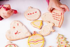Draw on gingerbread cookies Stock Image