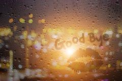 Draw good night on window. Draw good bye and kiss on window in raining day Stock Photos