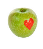 Draw on a green apple Royalty Free Stock Photography