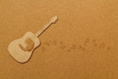 Draw guitar on brown cardboard. Stock Photography