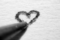 Draw a heart under a microscope Stock Photography
