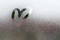 Draw the heart on vapor. At the glass Stock Photo