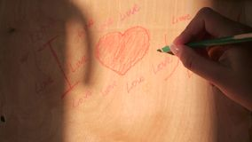 Draw hearts on a wooden board about declarations of love, 4k. Draw hearts on a wooden board about declarations of love stock video footage
