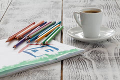 Draw house with pencil and cup of coffee stock photography