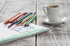 Draw house with pencil and cup of coffee stock photo