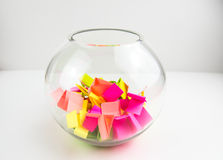 Draw lots. Small colorful paper pieces cut for randomly drawing lots in a glass transparent bowl Stock Photography