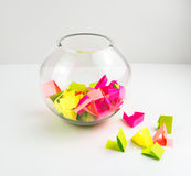 Draw lots. Small colorful paper pieces cut for randomly drawing lots in a glass transparent bowl Stock Images