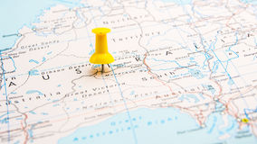 Draw-pin stick into real map Stock Photography