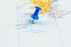 Draw-pin stick into real map Royalty Free Stock Photography