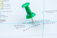 Draw-pin stick into real map. Identification of final destination, Mauritius Stock Images