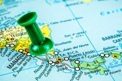 Draw-pin stick into real map, travelling to S Costarica. Closeup of draw-pin stick into real map, travelling to Costarica, identification of final destination royalty free stock images