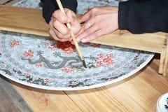 Draw porcelain process Stock Photo