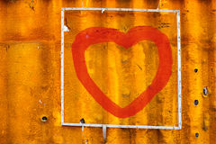 Draw red heart on old Containers background Stock Images
