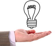 Draw's bulb above hand Royalty Free Stock Photo