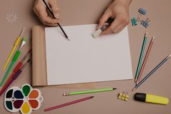 Draw in sketchbook. Creative artist workspace top view. Background of painting, art stationery royalty free stock photos