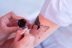 Draw a tattoo Stock Image
