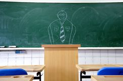 Draw teacher on the blackboard Stock Photography