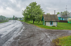 Draw-well as a small wooden house at roadside in Lyubka village, Sumskaya oblast, Ukraine Royalty Free Stock Photos