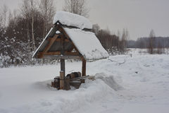 Draw well in snow. white snow, roofing slate, winter. Forest. Russia Siberia Royalty Free Stock Image