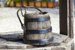 Draw well with wooden bucket Royalty Free Stock Image